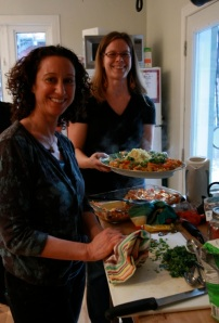 Host Jennifer and kitchen helper Erin put the finishing touches on their couscous