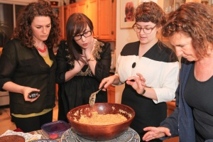 Roots & Recipes Team prepares couscous, Yolande Cohen overlooks