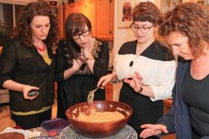 Roots & Recipes Team prepares couscous, Yolande Cohen overlooks