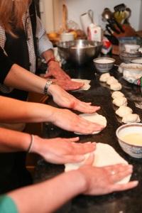 the volunteers learn to make Mufleta