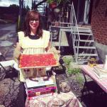 Kat presents a finished pizza napoletana. photo by Roots & Recipes